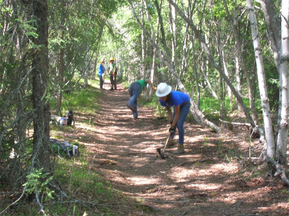 SCA Alaska Crewmembers working the trail