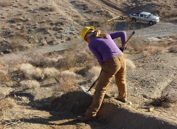 Erosion control methods on a hill-climb incursion. Here is Rachel creating a rock water bar.