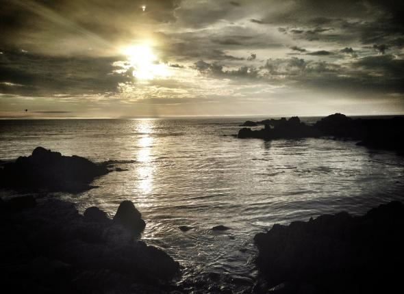 The sun setting over the Pacific at Asilomar Beach