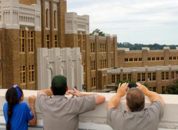 SCA Centennial Volunteer Ambassador Sally Goldman surveys Little Rock Central High with NPS staff
