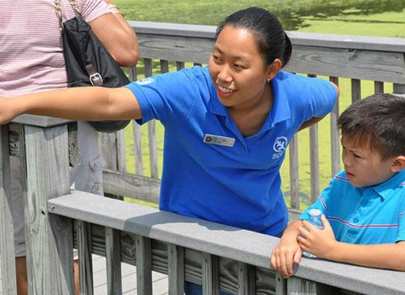 Mary Nghe, CDIP Intern with the Student Conservation Association  showing off natural wonders at the John Heinz National Wildlife Refuge.