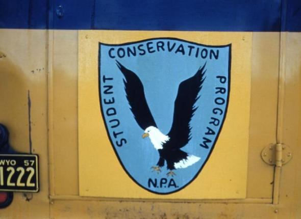 A hand-painted version of the original Student Conservation Association (SCA) logo.