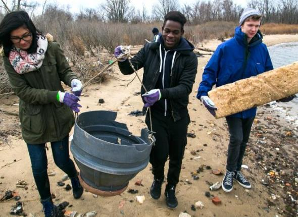 Volunteers gather storm debris along Jamaica Bay