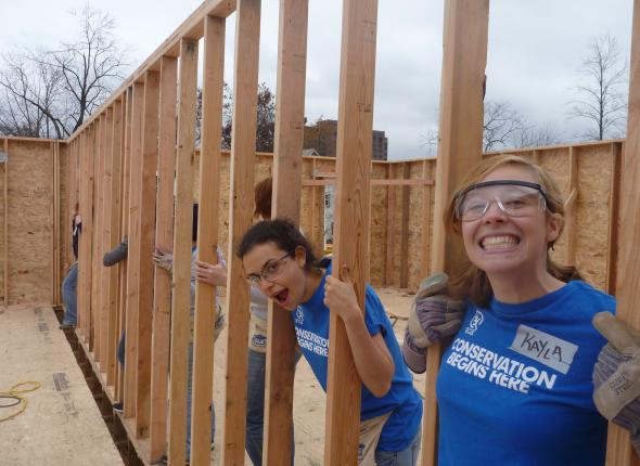 Jenna & I holding up a wall at Habitat for Humanity.