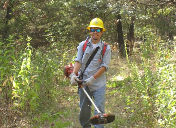 Ryne brushing the Tenkiller Overlook trail, with a power tool no less!