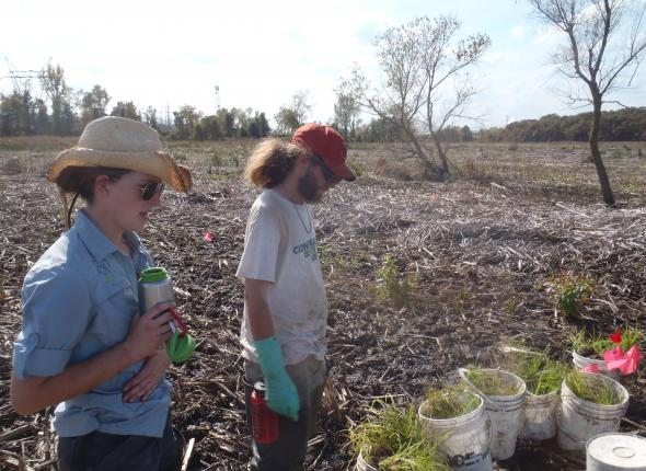 Rose and Danny preparing to install some plants in Cowles Bog