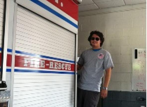Alex hanging out on the back of one of the fire engines at Allen Fire Department in Cabarrus County.