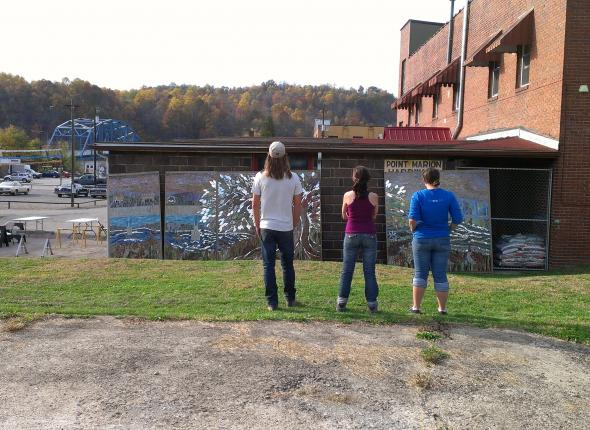 Ryan, Cat, and Sam taking a look at Point Marion's new public art project