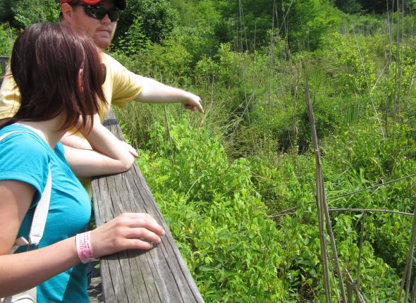 Conservation day: Sardis hike. John points out an invasive nutria trail to the group.