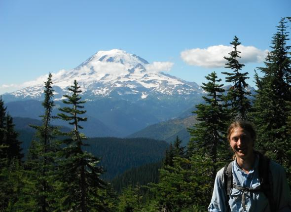 Austin poses in front of Mount Rainer on the Pacific Crest Trail