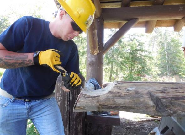 Gabe shaping the log for its final site