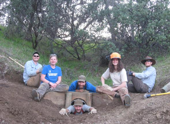 Our crew poses over a culvert we replaced and reinforced on our new section of trail at Smittle Creek Day Use Area.
