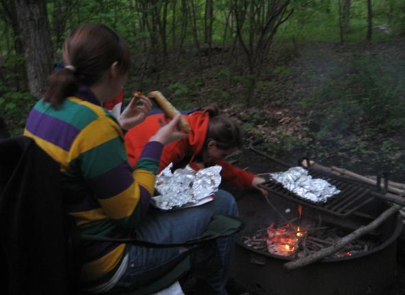 Enjoying some campfire pizza