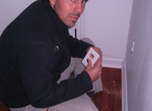 Josh in time out, Just Kidding! Josh installing outlet insulators and switch plates.