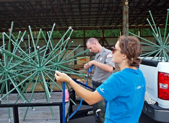 Ranger Craig Sowers and Sophie tie down fish attractors at the vehicle yard at Lake Sidney Lanier.
