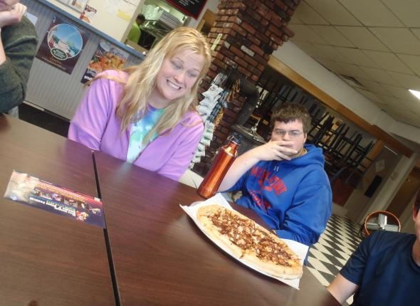 Kayla and Lucas excitedly awaiting for the rest of the pizzas to arrive at our table
