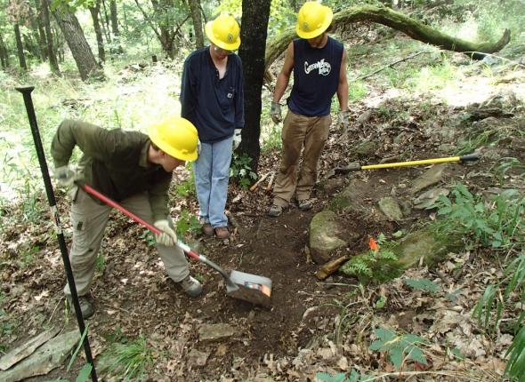 The guys installing a rock step on Fort Gibson Lake's Overlook Trail.