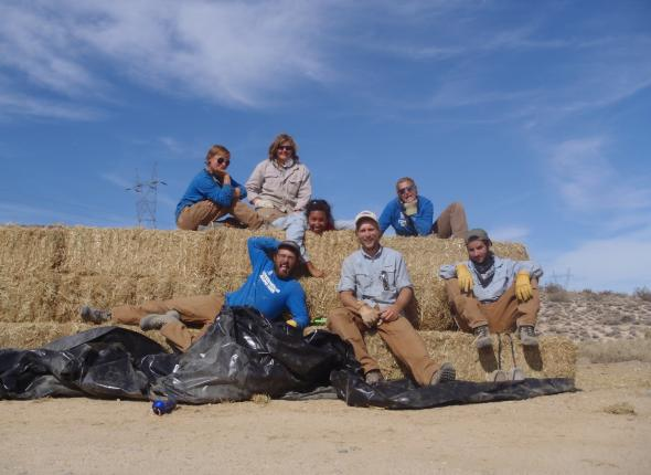 Group photo on a massive straw bale stack.