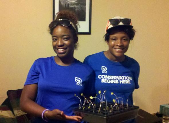 Bree and Tishena w. their sprouting flowers