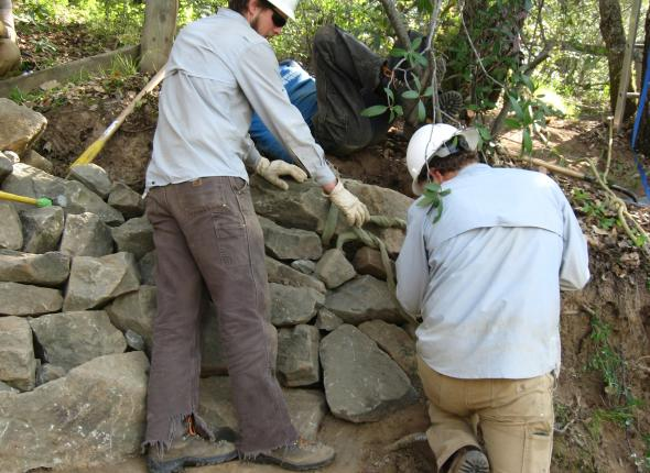 Used a highline to set the capstones on the wall