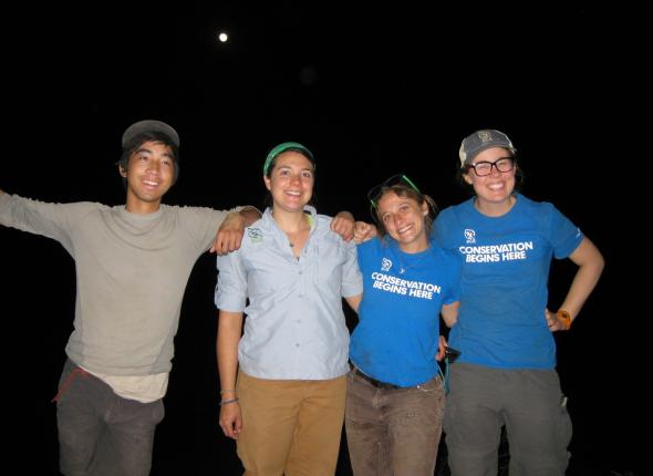 The crew posing by the full moon...
