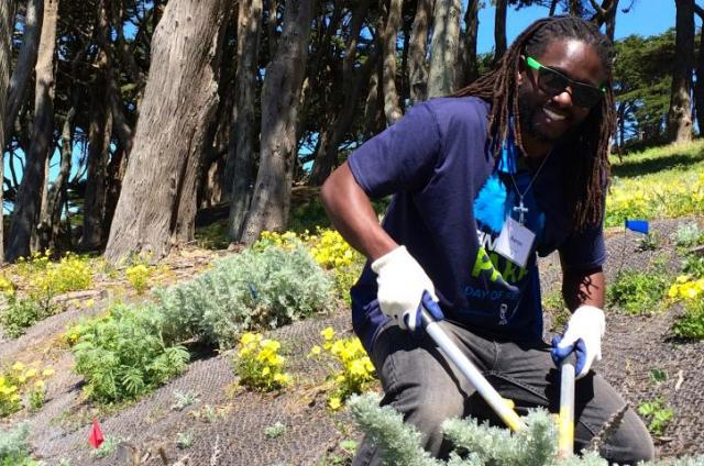 SCA leader Aaron Gray pulls invasives at an SCA event in San Francisco