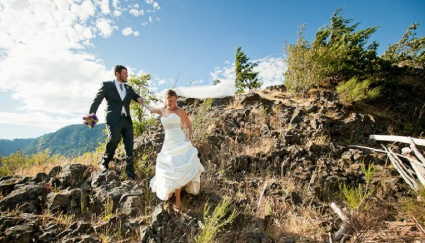 Amanda and Mikel on a rocky outcropping on their wedding day