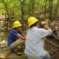 Alaina and Ryne repairing a bridge on the Tenkiller Overlook trail.