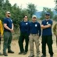 The Student Conservation Association's Prescott Veterans Fire Corps relax after a prescribed burn in the Prescott National Forest