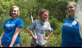 SCA Centennial Volunteer Ambassadors prepare to net invasive crayfish during their late May training session at Valley Forge National Historic Park.